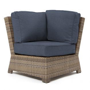 Cabo 90 degree corner section with a Willow weave and Spectrum Indigo cushions