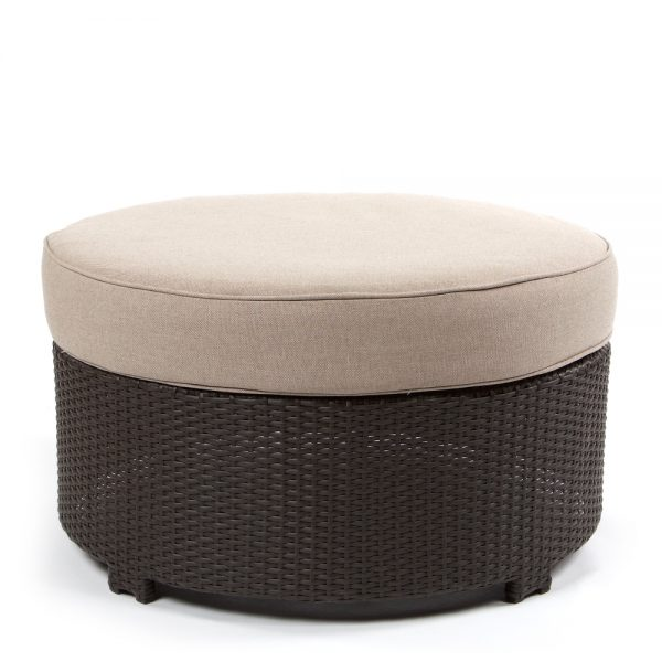 Cabo round ottoman with a Jacobean weave and Blend Sand cushion