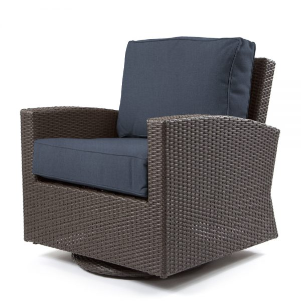 Cabo swivel glider club chair with a Jacobean weave and Spectrum Indigo cushions