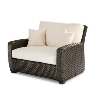 Leeward wicker cuddle chair with cushions and throw pillows