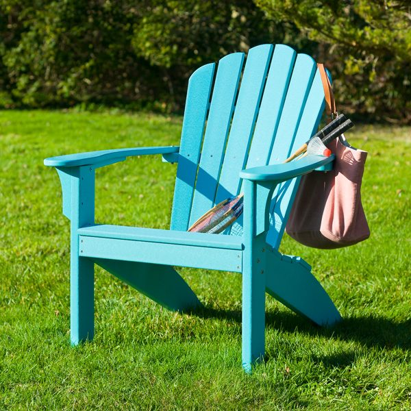 Teal Adirondack chair on the grass