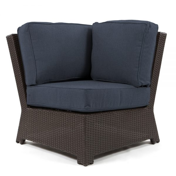 Cabo 90 degree corner section with a Jacobean weave and Spectrum Indigo cushions