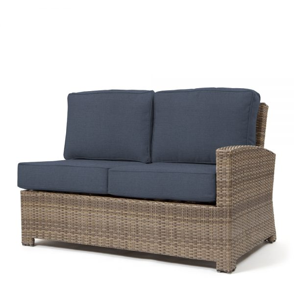 Cabo wicker right arm facing love seat section with a Willow weave and Spectrum Indigo cushions