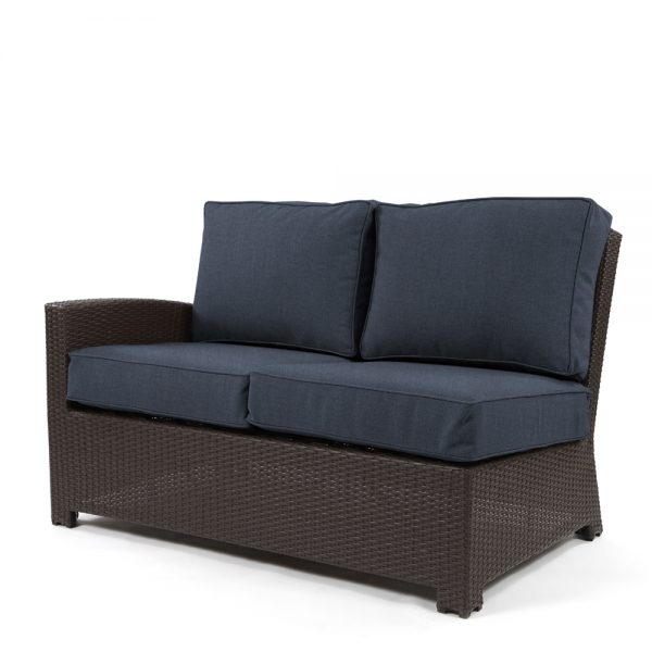 Cabo wicker left arm facing love seat section with a Jacobean weave and Spectrum Indigo cushions