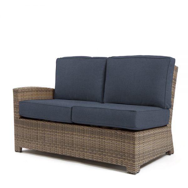 Cabo wicker left arm facing love seat section with a Willow weave and Spectrum Indigo cushions