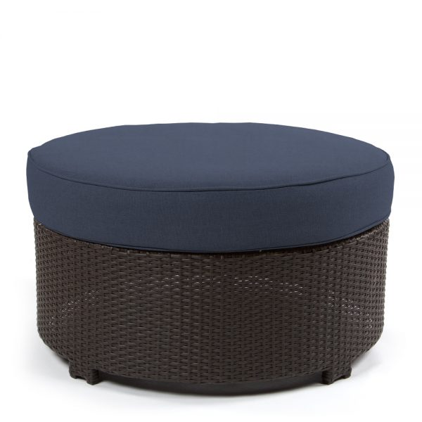 Cabo round ottoman with a Jacobean weave and Spectrum Indigo cushion