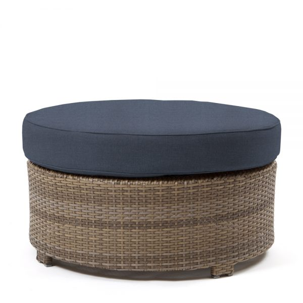 Cabo round ottoman with a Willow weave and Spectrum Indigo cushion