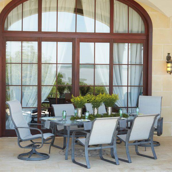 Woodard Cayman Isle padded sling aluminum dining furniture