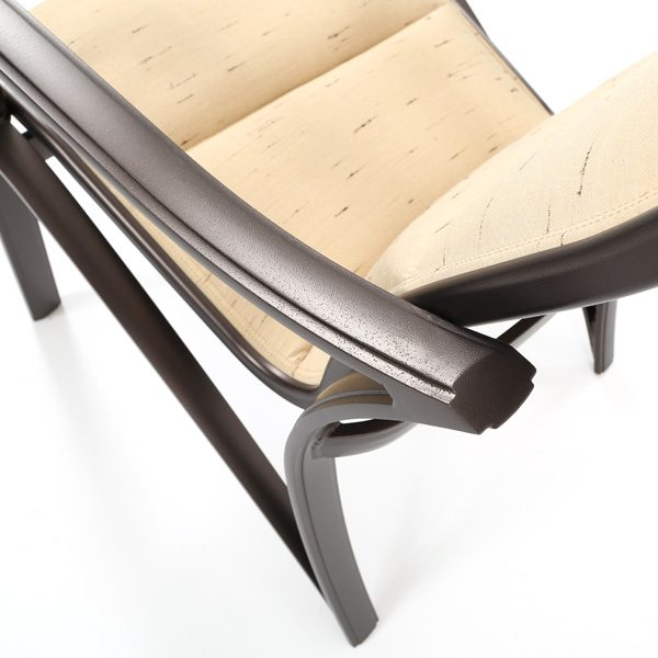 Tropitone Corsica padded sling dining chair with an aluminum frame and Espresso powder coat finish