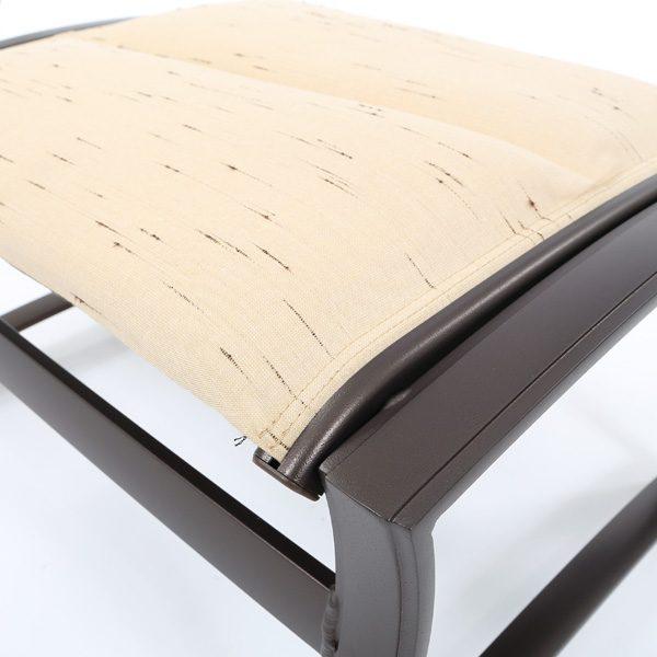 Tropitone Corsica padded sling ottoman with Harvest Mis Sunbrella fabric