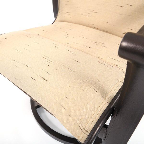 Tropitone Corsica padded sling swivel rocker with Harvest Mist Sunbrella fabric