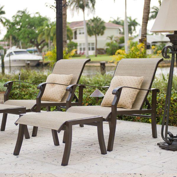 Woodard Cortland sling adjustable lounge chairs and ottoman