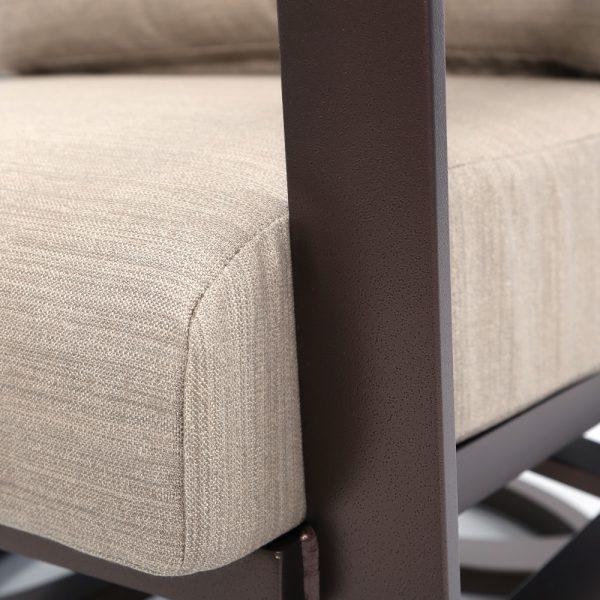 Tropitone Kenzo swivel action club chair with Sunbrella Light Brewed outdoor fabric
