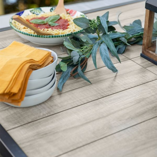 Apricity Oak Grove outdoor dining table with a Porcelain Saddle tile top