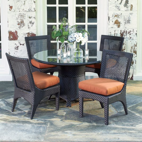 Woodard woven dining furniture