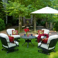 Use pillows and throws to add color to your outdoor patio furniture
