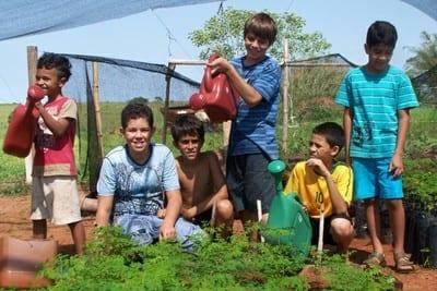 Trees for Life - Kids watering garden